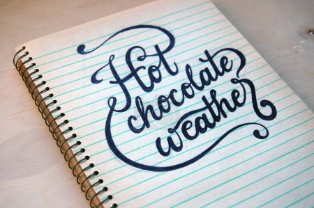Photo for Hot chocolate weather, on old spiral notebook - Royalty Free Image