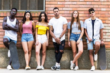 Photo for Portrait of group of young hipster friends looking at camera in an urban area. - Royalty Free Image