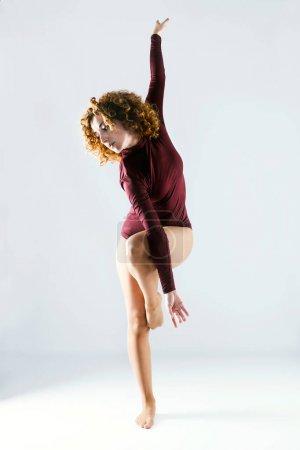 Beautiful young professional dancer dancing over white backgroun