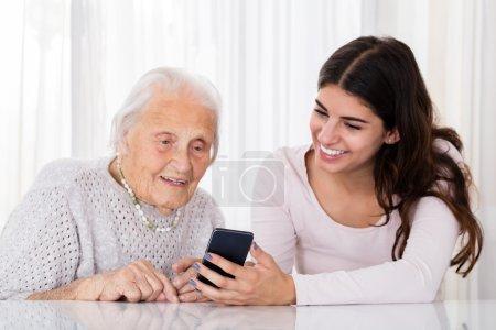 Two Women Using Smartphone
