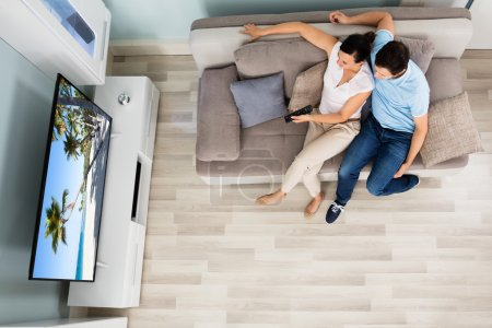 High Angle View Of Couple Watching Television