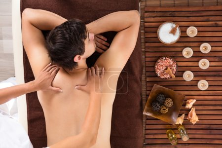 Young Man Receiving Massage In Spa