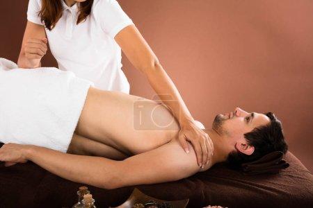 man receiving massage treatment