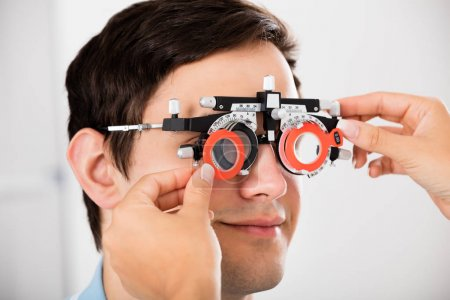 Male patient at optometrist testing
