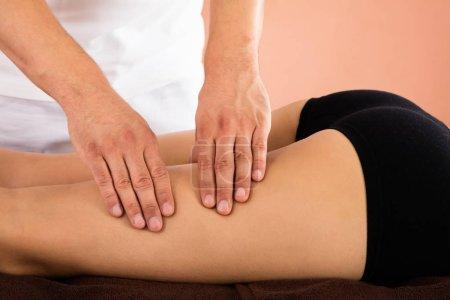 woman receiving leg massage
