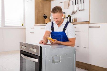 Technician Checking Oven