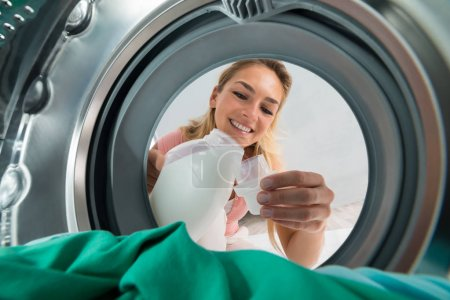 Smiling Woman Pouring Detergent