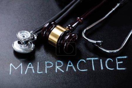 Malpractice Concept On Blackboard
