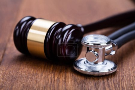 Closeup Of Gavel With Medical Stethoscope On Woode...