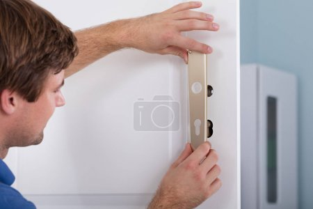 Carpenter Installing Door Lock