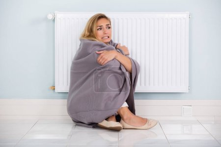 Woman Sitting Near Heater