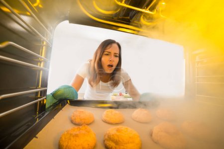 Woman Looking At Burnt Cookies