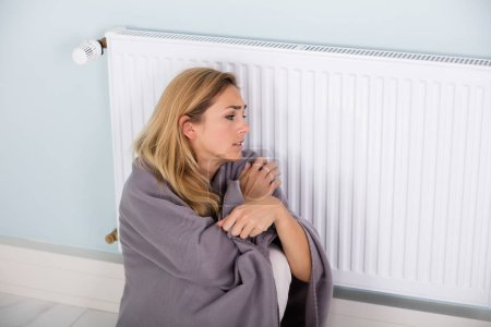 Woman Sitting Near Thermostat