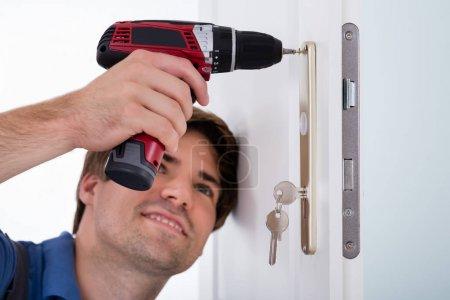 Male Installing Door Lock