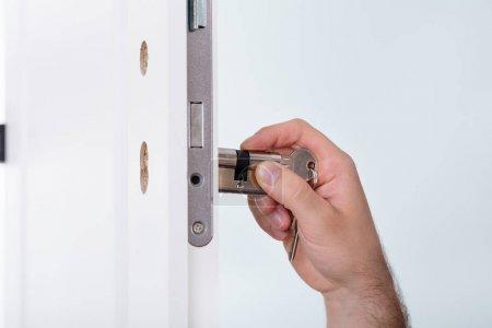 Man Installing Door Lock