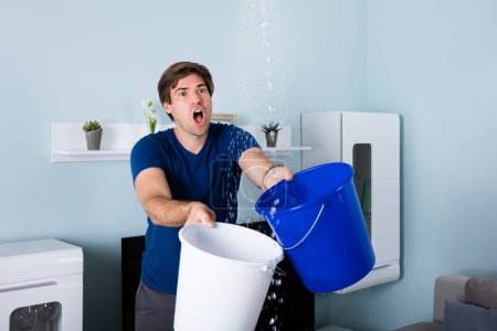Man Holding Bucket