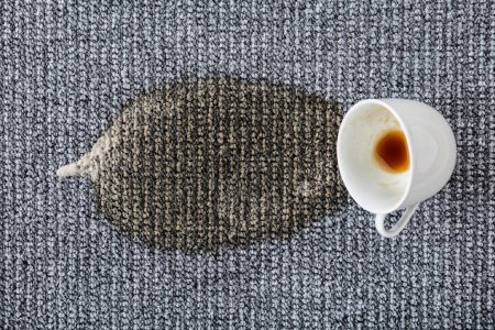 Photo for Coffee Drink Cup Spilled On Carpet - Royalty Free Image