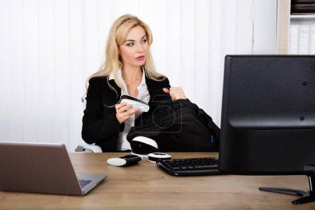 Businesswoman Stealing Stapler