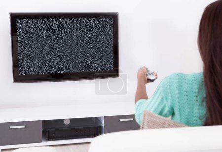 Woman Watching Television Showing No Signal