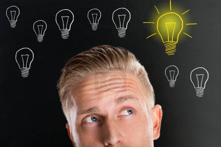 Young Man With Creative Bulb