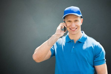 Delivery Man Using Cellphone