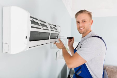 Technician Fixing Air Conditioner