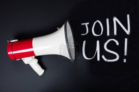 Join us text With Megaphone On black Blackboard...