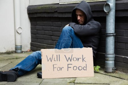Unemployed Man With Signboard