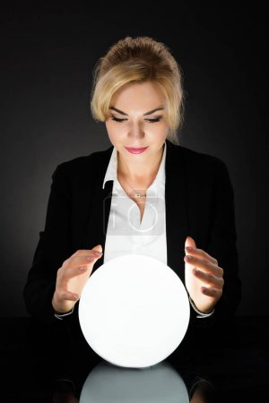 Businesswoman Looking At Crystal Ball