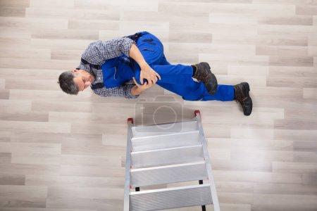 Repairman Falling From Ladder