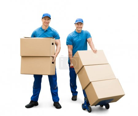 Photo for Two Delivery Men With Cardboard Boxes On White Background - Royalty Free Image