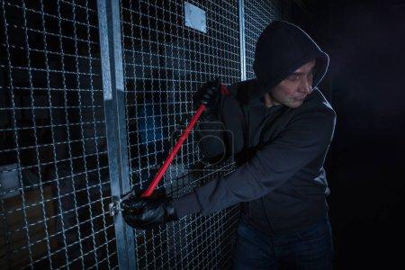Burglar Breaking Gate