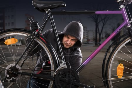 Thief Breaking Bicycle Lock