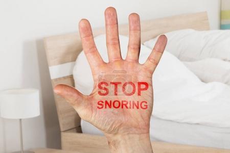 Stop Snoring Written On Hand