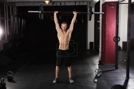 Athlete Man Lifting Barbell