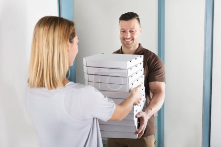 Delivery Man Giving Pizza