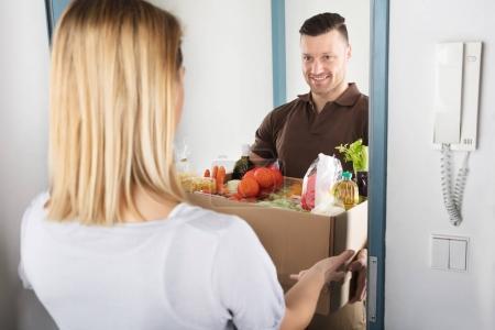 Woman Accepting Cardboard