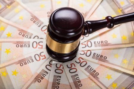 Gavel Strike On Banknotes