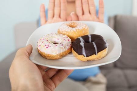 Woman Rejecting Doughnuts