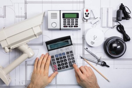 Male Engineer Using Calculator