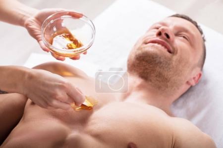 Therapist Applying Wax