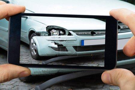 Person Capturing Broken Car
