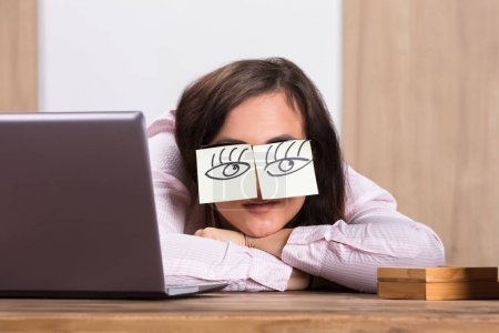 Sleeping Businesswoman Covering Eyes