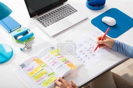 Businesswoman Marking Schedule