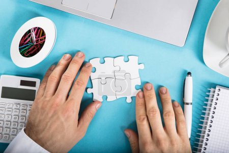 Businessperson Joining Puzzle