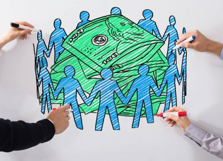 Close-up Of Business People's Hands Drawing Crowd Funding Chart With Marker On Whiteboard
