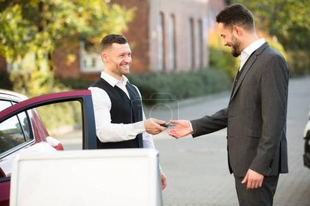Businessman Getting Car Key