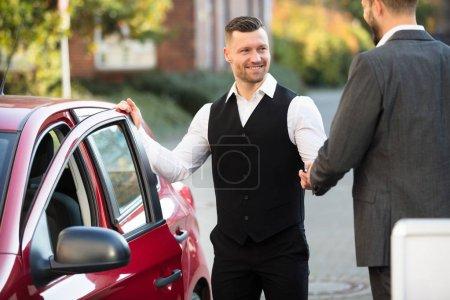 Businessperson Standing Near Car