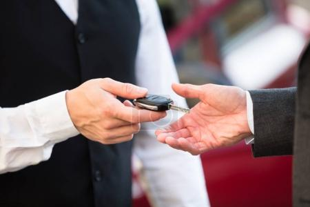 Valet Giving Key To Businessperson