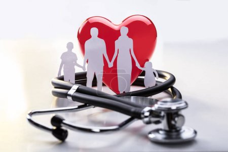 Medical Insurance Concept With Family Cut-out And Stethoscope On Desk